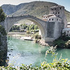 Stari Most (the new Old Bridge - 2004), the Old Bridge, built in 1557 by Turkish Muslim ruler, Suleyman the Magnificent, was destroyed by Croats in 1993 with shelling from the top of the hill, marked by a cross.