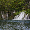 Lake waterfalls on boat ride at Plitvice Nat'l Park