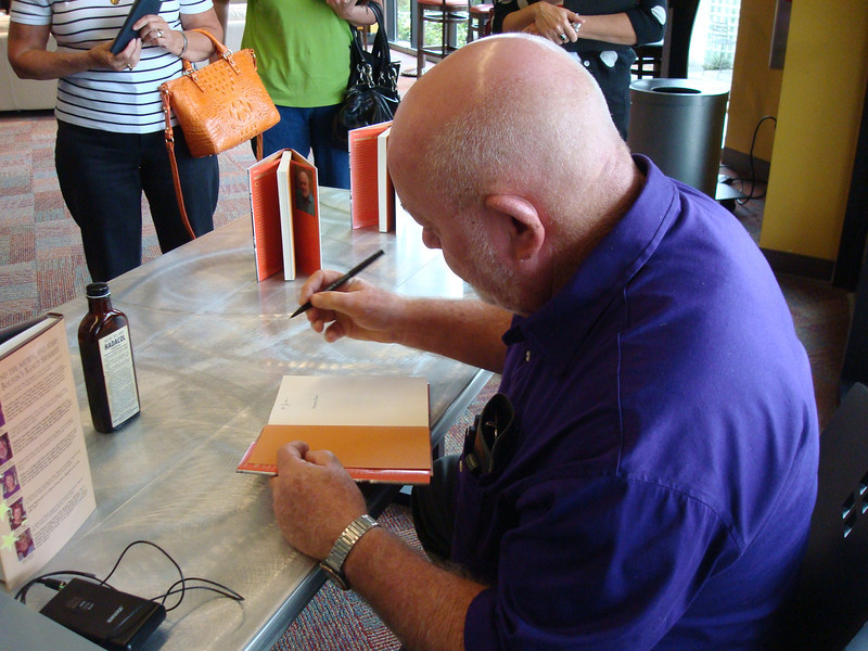 Author Clyde Bolton signing copies of his book.