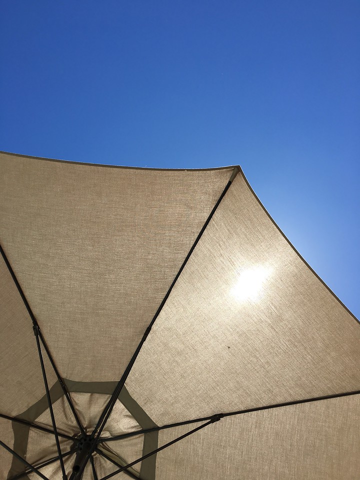 Sun Beaming Through Umbrella