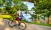Cyclist on flooded waterfront of Little Rock, Arkansas; south end of Junction Bridge - _1C30016 - 72 ppi-2