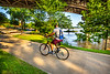 Cyclist on flooded waterfront of Little Rock, Arkansas; south end of Junction Bridge - _1C30016 - 72 ppi