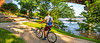 Cyclist on flooded waterfront of Little Rock, Arkansas; south end of Junction Bridge - _1C30017 - 72 ppi-2