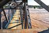 Bikers on Junction Bridge above flooded Arkansas River - _W7A0053 - 72 ppi