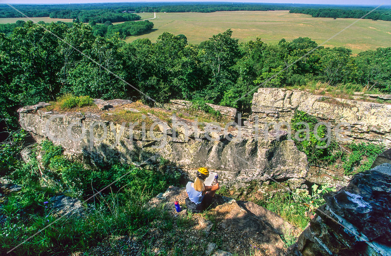 Cyclist with battle map at overlook in Arkansas' Pea Ridge National Military Park - 1-Edit - 72 ppi