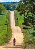 Biker on CR 2545, 6 miles south of Marble, ACA's Northwest Loop - C1_1C30006 - 72 ppi-2