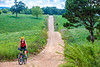 Biker on CR 2545, 6 miles south of Marble, ACA's Northwest Loop - C1_1C30054 - 72 ppi