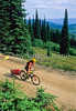 Touring cyclist(s) on Lolo Trail in Idaho's Bitterroot Mts; Forest Road 500 - 8 - 72 ppi