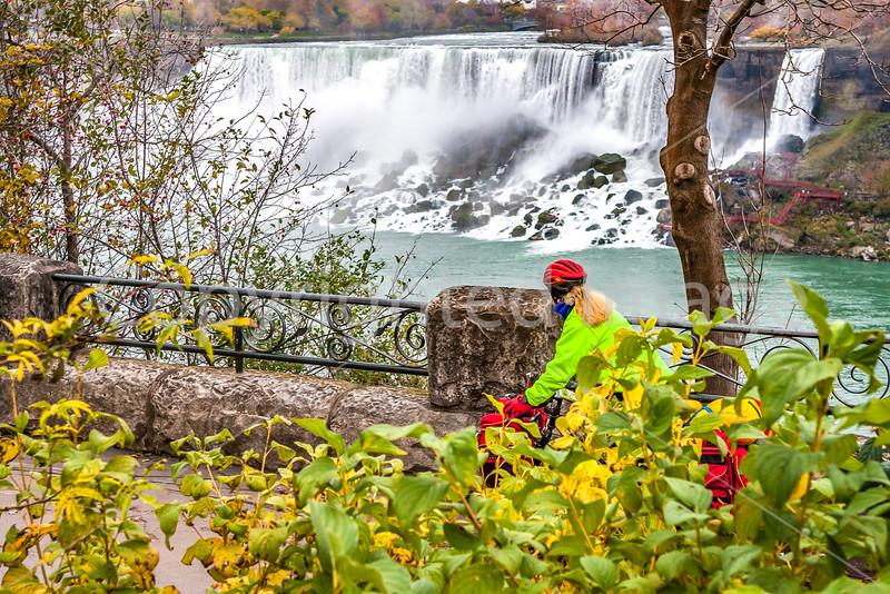 Touring cyclist viewing American side of Niagara Falls, NY-0507 - 72 ppi