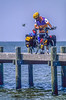 Touring cyclist on dock at Fairhope, Alabama, on Mobile Bay - 3-Edit - 72 ppi