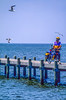 Touring cyclist on dock at Fairhope, Alabama, on Mobile Bay - 5-Edit - 72 ppi