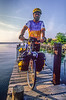 Touring cyclist on Dauphin Island near Fort Gaines in Mobile Bay, Alabama - 2-Edit - 72 ppi