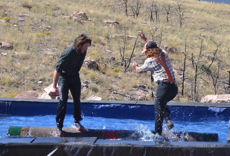 Brian Stearns and Nick Hastedt of the Timberworks Show compete in a log rolling contest Saturday during the Royal Gorge Bridge & Park's nine-day Adventure Fest. Carie Canterbury/Daily Record 9-10-16