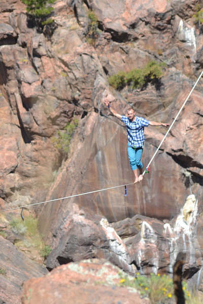 Taylor VanAllen of Rocky Mountain Slackline walks several hundred feet above a gulch at the Royal Gorge Bridge & Park on Saturday during the nine-day Adventure Fest. Carie Canterbury/Daily Record 9-10-16