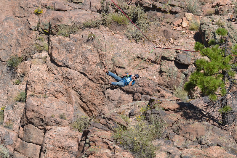 Davis Dailey of Rocky Mountain Slackline dangles from high above a gulch at the Royal Gorge Bridge & Park on Saturday during the nine-day Adventure Fest. Carie Canterbury/Daily Record 9-10-16