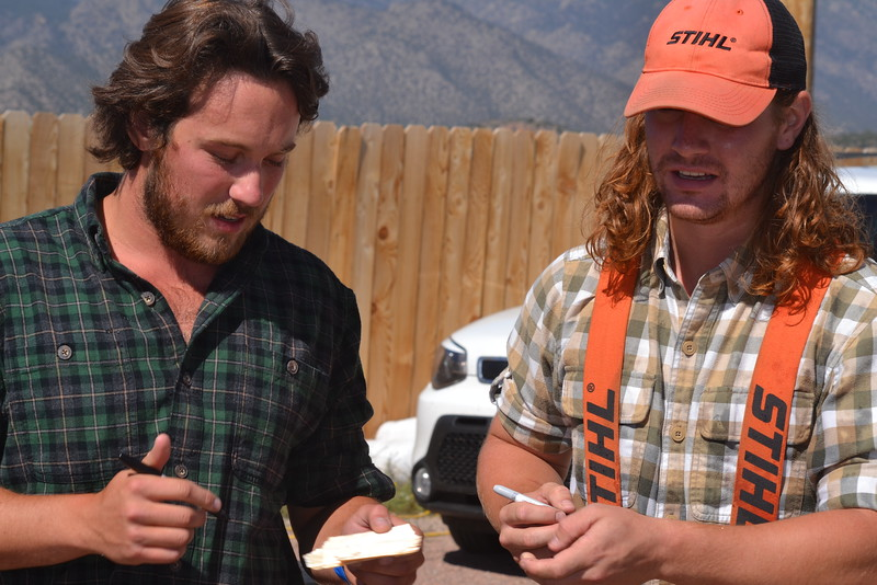 Brian Stearns and Nick Hastedt of the Timberworks Show autograph chunks of wood Saturday during the Royal Gorge Bridge & Park's nine-day Adventure Fest. Carie Canterbury/Daily Record 9-10-16