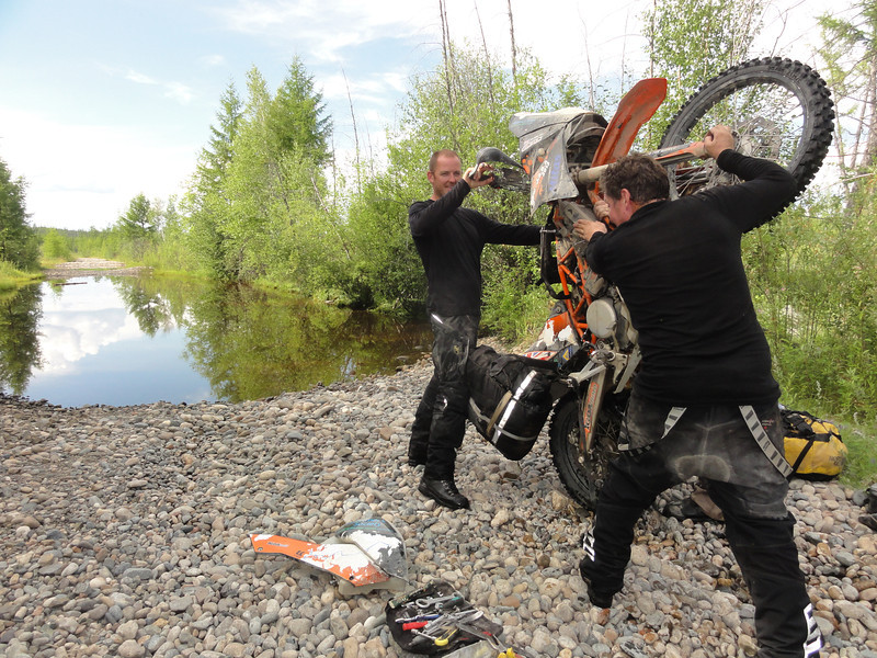 Draining the water from Jon Boulton's KTM after an impromptu dunking