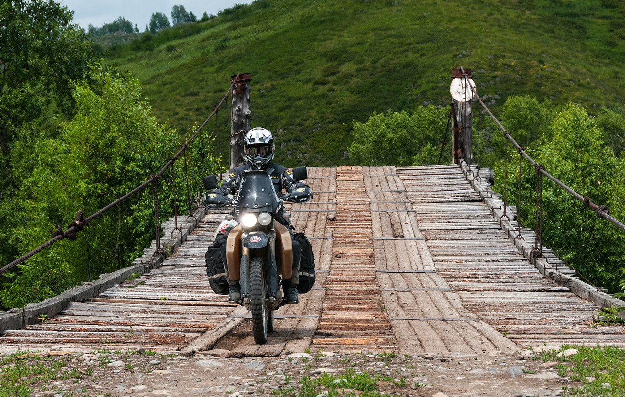 Adam Lewis crossing the lovely old wooden suspension bridge near Sentelek (Gareth Griffiths photo)