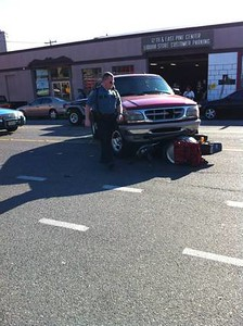 "This photo stolen from the news blog- <a href=""http://www.capitolhillseattle.com/2011/06/29/truck-vs-scooter-at-12th-and-pine#commentform"">http://www.capitolhillseattle.com/2011/06/29/truck-vs-scooter-at-12th-and-pine#commentform</a><br /> Reason I have uploaded it here, this was the demise of one of the poor 'Zaw scooters, which I took the other photos of here in this gallery. no it was not the riders fault, the Ford driver had drivin out of the parking garage at the liquor store, running over the scooter and rider, dragging her and the scooter all the way across the street before stopping. She is alive and recovering, the scooter is not."