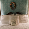 Cute vintage four poster bed and decorations in a bedroom in a bed and breakfast