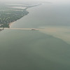 Canal empties brown water into lake Erie in upstate New York
