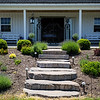 Front walkway of a cute rural farmhouse in upstate new york