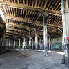 Fire damaged interior of a large train roundhouse and depot in upstate New York