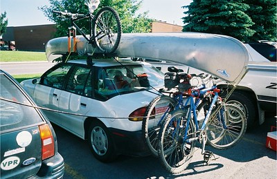 Locked canoes, bikes, racks, and cars - nice!