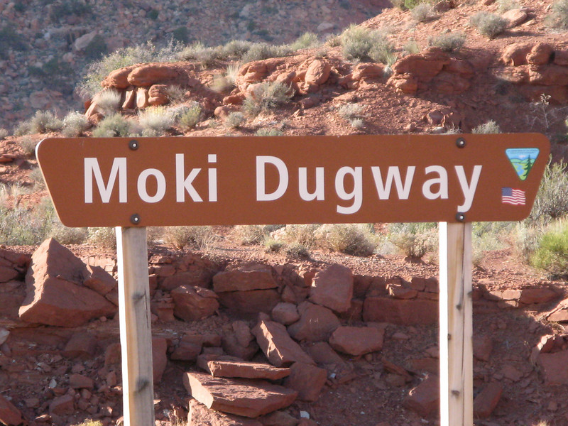 The Moki Dugway is a narrow switchback road carved into the side of a mesa.