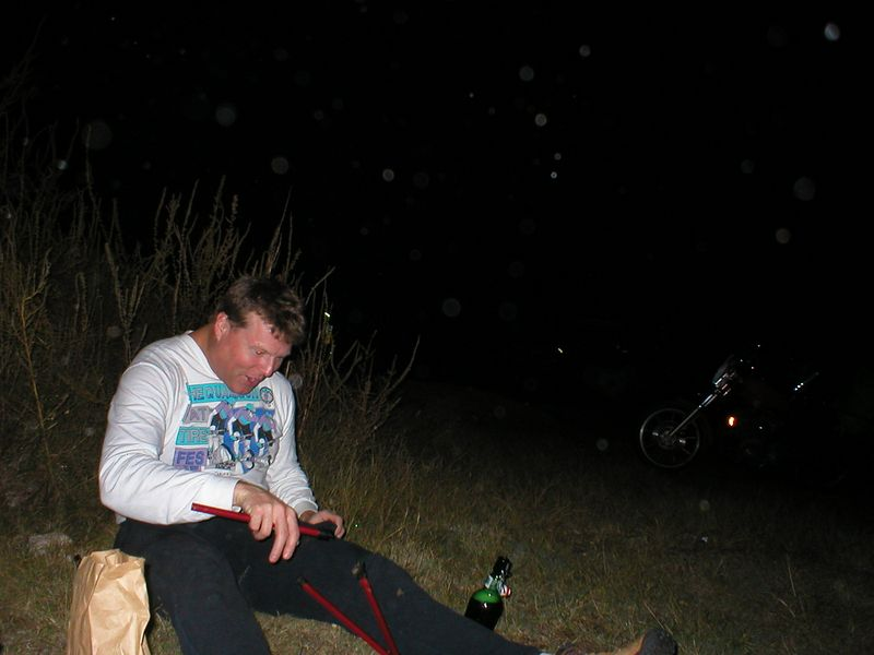 Foods down, beers cracked and the exuberating begins! Tom expounds then Boom, broken chair. I'm glad I had the camera.