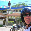 Dominican Republic Road Survival Skills:<br /> <br /> The majority of the motorcycles you see in the DR are 125cc or less and that means most motorcycles cannot keep up with highway traffic. When we lived here before, we owned a Yamaha DT125 Enduro and traveled all round the island. We pretty much have the same motorcycle today except the engine is water-cooled and the rear suspension is mono-shock. Anyway, when we are riding 2-up, we cannot keep up with highway traffic. It took only one day of riding for us to remember what the rules are for motorcycle traffic in the Dominican Republic.<br /> <br /> Rule #1: Motorcycles must ride in the extreme shoulder of the road. Oncoming traffic will pass at will if there is only a motorcycle coming at them. And of course the motorcycles here have NO rear view mirrors, so even when there is no oncoming traffic, motorcycles need to assume a car or truck or a faster motorcycle is speeding up behind them ready to pass. In addition, if you are not riding far enough over onto the shoulder, passing vehicles will let you know the rule by passing with only inches to spare between you and them. This only happened to us once or twice before I remembered the rule.<br /> <br /> Rule #2: Always expect the unexpected. Oncoming cars, trucks, or whatever appear in your lane at anytime. In the village Sosua, there are a lot of one-way roads, but that means nothing except that if you are going the wrong way you are expected to yield first, unless of course you are a larger vehicle.