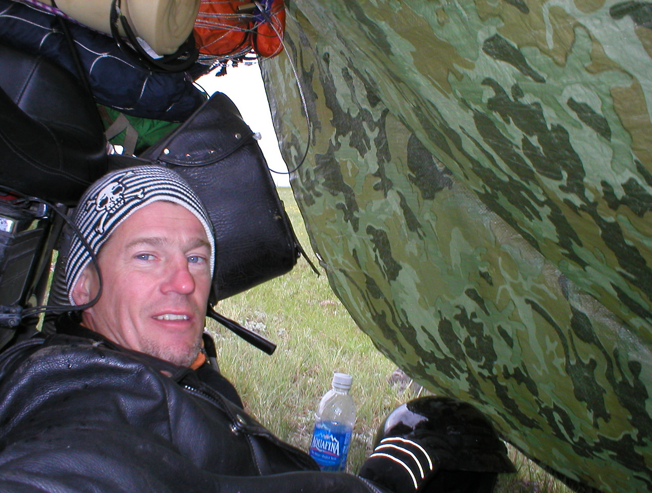 The storm with a lot of wind came and went. I stayed warm and dry while eating lunch in my little lean-to shelter. One rock I chose for a tie down was insufficient. In the middle of the storm I had to lash one end of the tarp to my boot. It was a little tense but it worked.
