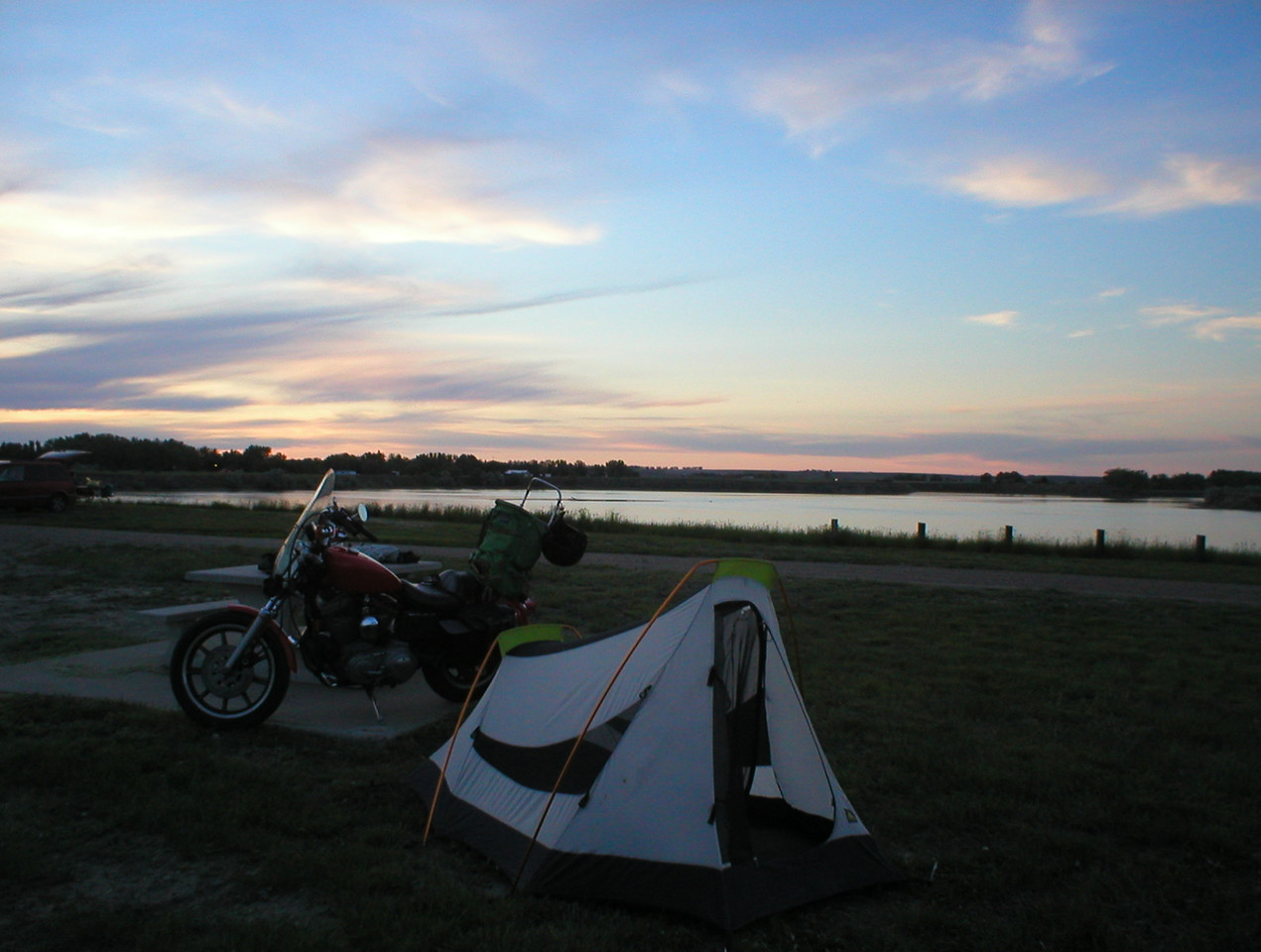 I make it to extreme northwestern North Dakota the second day and found an idyllic oasis in the middle of nowhere. I camped on the tip of a peninsula jetting out into a small lake. A couple blocks away are a few bait shops and bars. The camping is free here and the beer tasted good.