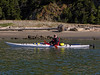 Bret paddling along the Swinomish channel out into Skagit Bay toward Goat Island.