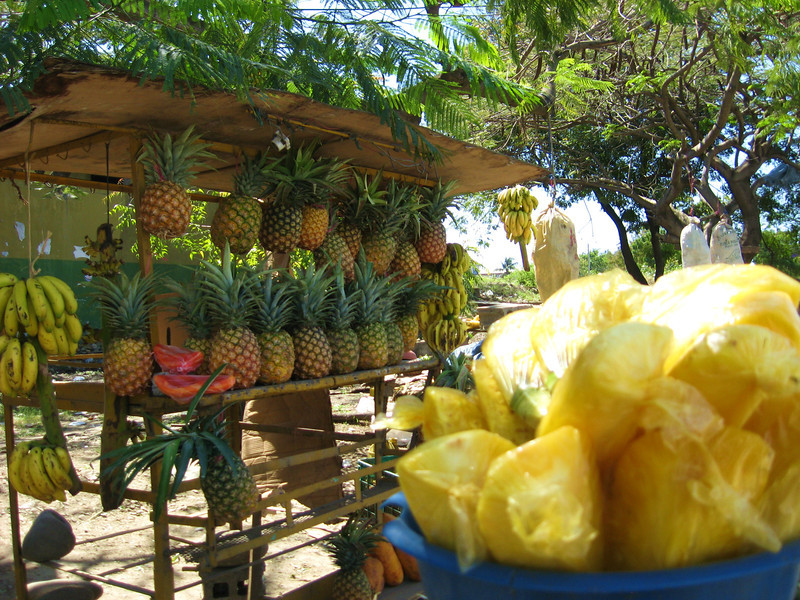 Pineapple quartered and bagged for 20 pesos.