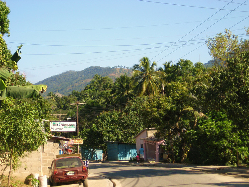 More small villages along the border with clean streets and palm trees.