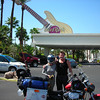 We were not going to spend a hundred and some bucks just to sleep, so we head straight to the Motel-6, on Tropicana Blvd, just a few blocks off Las Vegas Blvd. Under fifty bucks. We are out of the Motel-6 at eleven, It was like a hundred degrees outside. We shoot straight to the Hard Rock casino, just up the street.<br /> <br /> Obligatory shot: Heidi was claiming 'Helmet hair'<br /> <br /> <br /> The same bell guy that's helped us the last few years is here again. He pretends like he remembers us. How nice.<br /> <br /> We unload our tent, sleeping bags, tarp, leather jackets and a backpack with clothes. We can't get into our room yet but our buddy will store our stuff and have someone bring it to our room later. All Right.