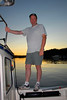 Jay at sunset on the rail of my C-Dory 22 Cruiser