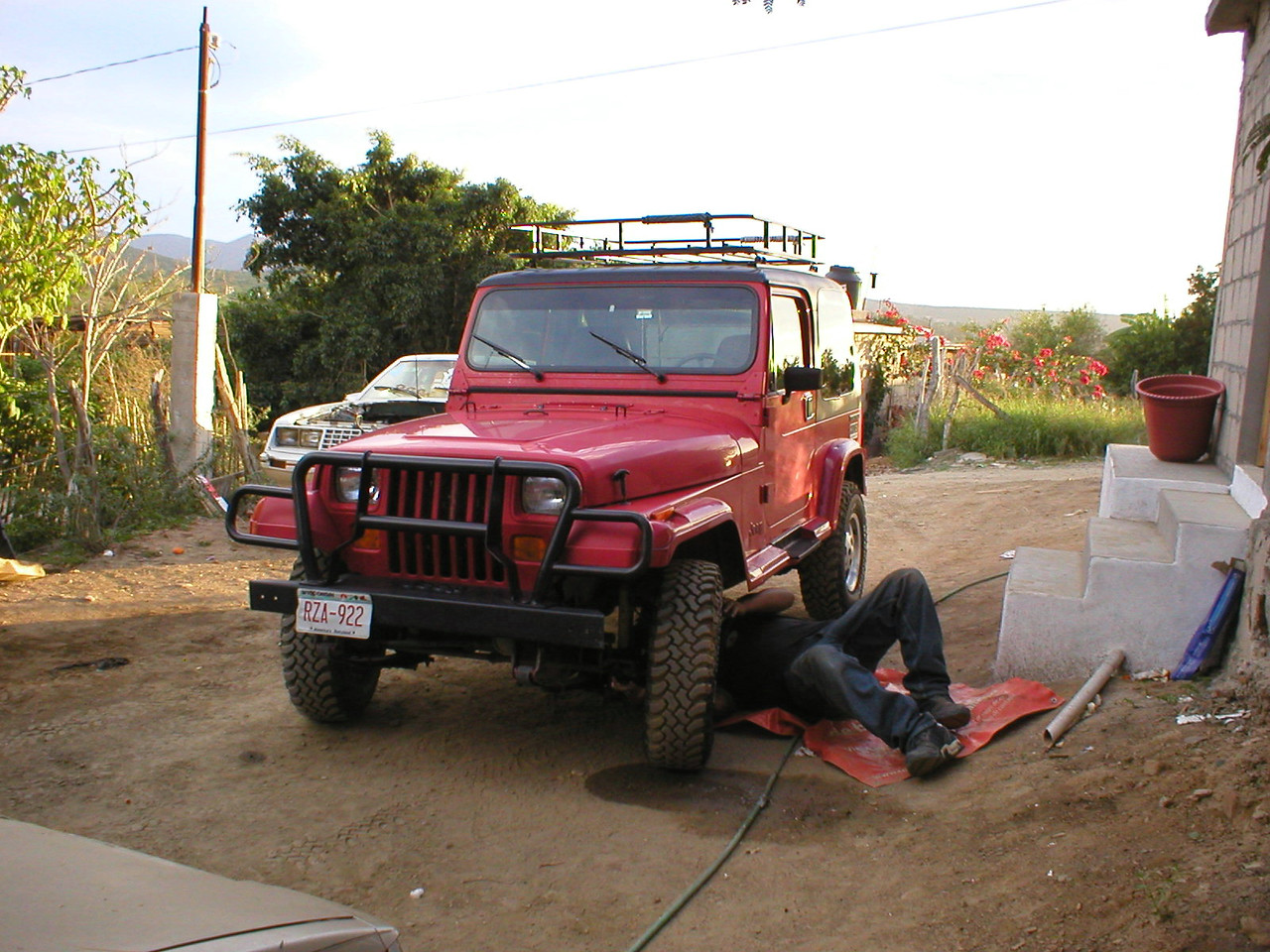 Cristian pulls up and shows me all the stuff he did, the jeep was spotless inside and out. We drive the jeep over to look at his new lot, he yells out the window at his girlfriend along the way. <br /> <br /> I love Mexico.