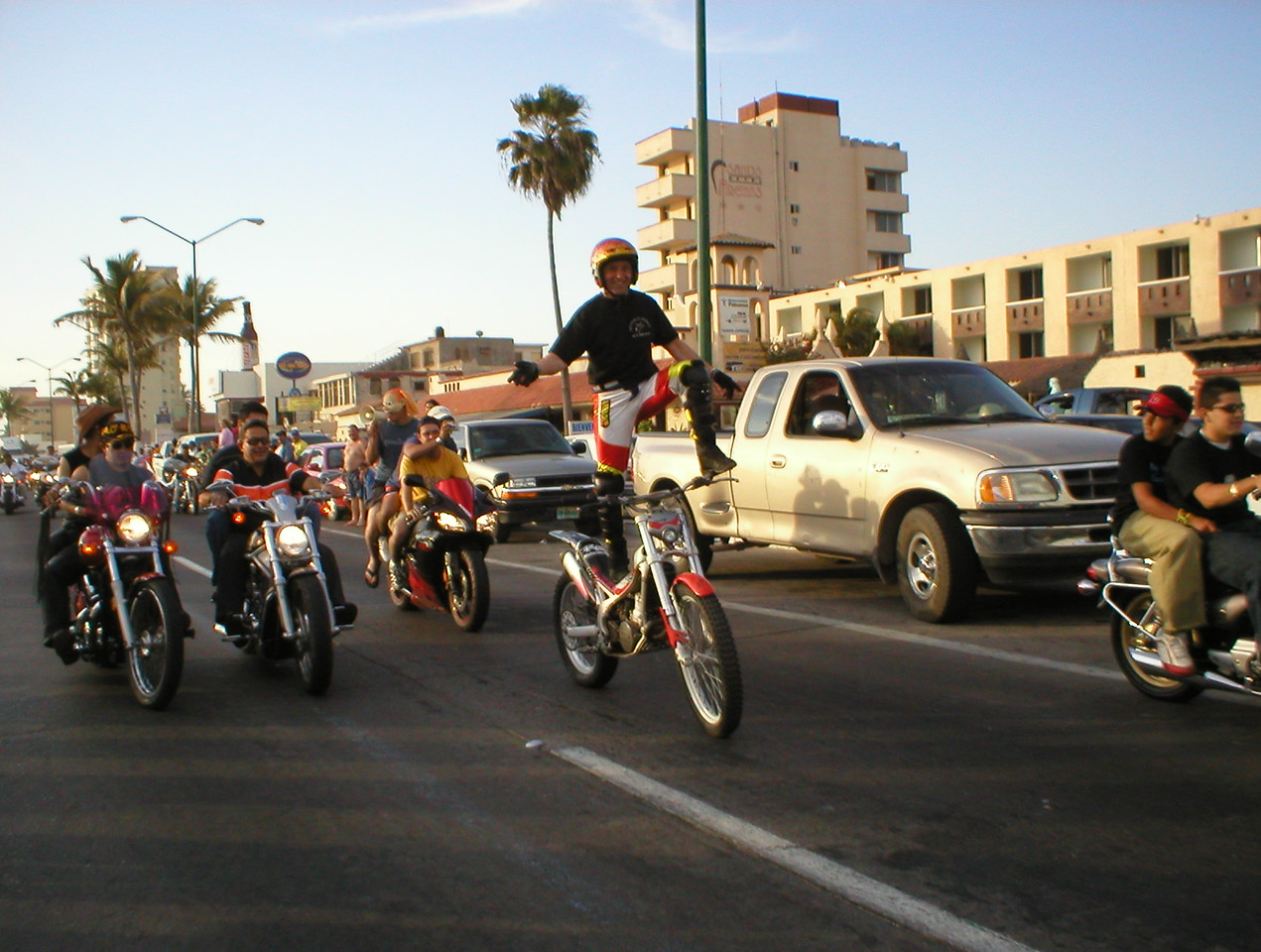 "I'm on my way to the gym walking when an official looking dune buggy was coming toward me, a guy stood up, pointed his megaphone at me and said (what I picked up) ""Oye! Listo por gran paseado"", ""Hey you, get ready for the grand parade!"" All the biker's parade along the malecon for bike week and this is it. It seemed like everyone in the whole town was lining up along the malecon to watch."