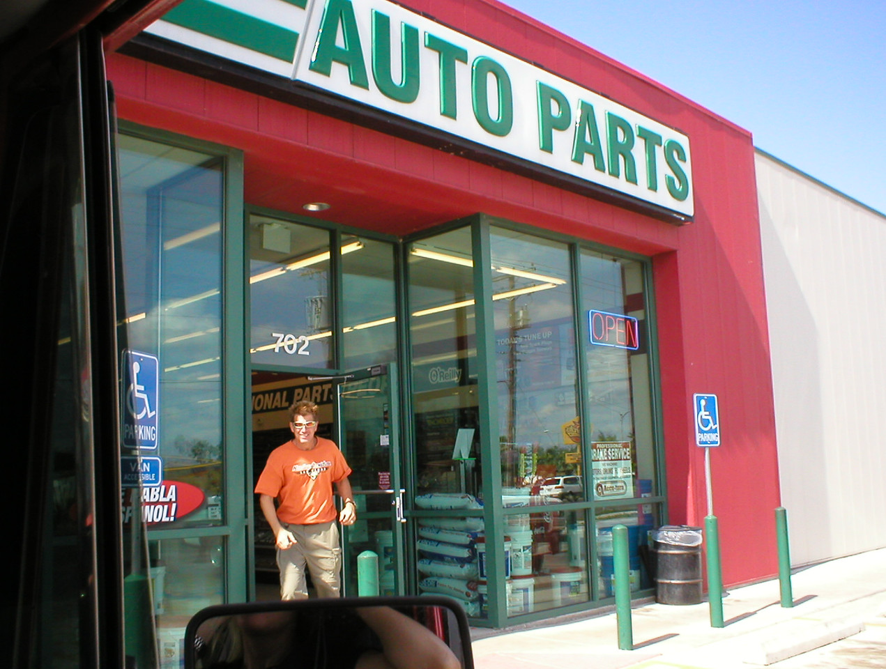 I'm not making any of this up! A mile or two across the border we thought the drive shaft was going to fall off again. 250 miles, we've gone through another U-joint. I know it has to be that wrong bracket holding the U-joint in place that is the problem. A mile or two later I see this auto parts store. I go in and buy two new U-joints and a matching bracket set, about $25.