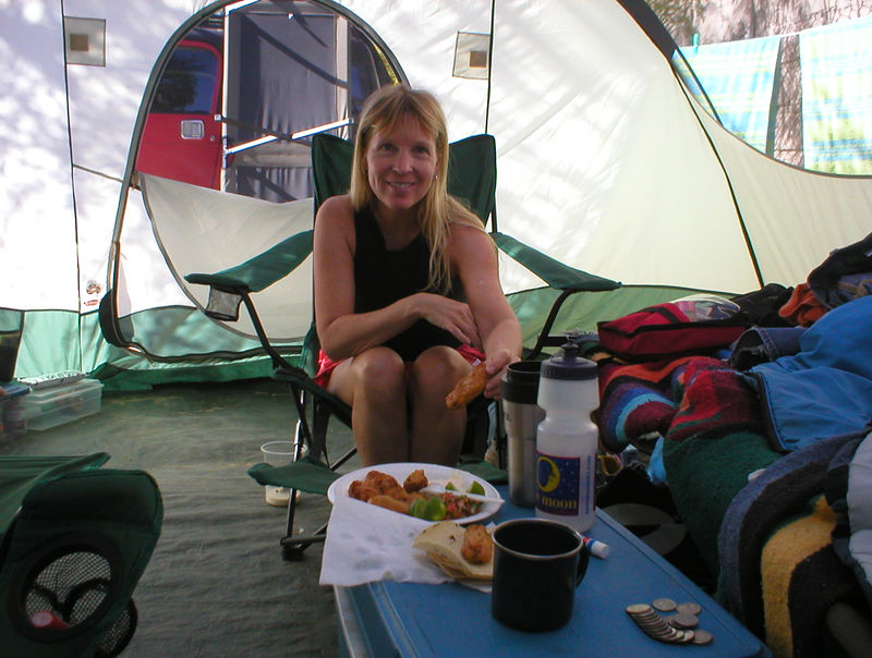 "Thursday came and it was the weekend of Easter, this is a huge weekend for Mexicans. The camp area and beach was filling up. We found our tent surrounded by Mexican families all setting up for the weekend. Baja Mexicans sure know how to camp bringing tables, chairs, grills, electric coffee makers, deep fryers, stereos and whatever. The gringo RV'ers were storming out not wanting to be part of the scene saying ""There's so many Mexicans here!"" We thought to ourselves, Duh, this is Mexico. Friday morning Heidi and I are up drinking coffee and reading in our tent when all of sudden a neighbor pops up at our tent door with a plate of food, deep fried fish, cut limes, cilantro, mayo and tortillas, what a friendly gesture! The fish was some of the best we have ever had, it was called Cabrilla. 