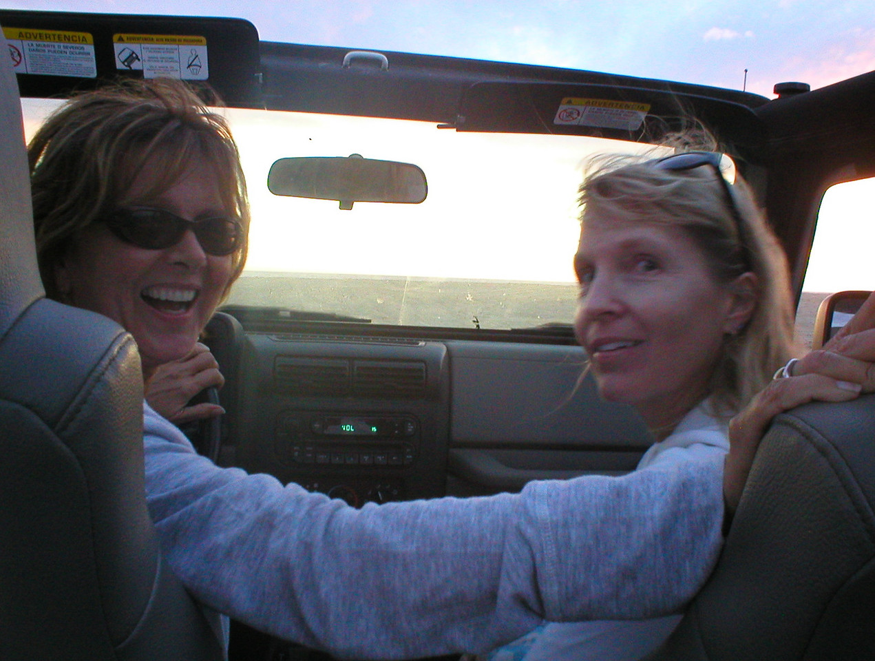The next thing I know I find myself in the back of a topless jeep with two babes in control and we're on our way to the world class surf beach. This is Ruth on the left, she came down for the first time three weeks ago on vacation and has extended her stay because she's buying a home here to live full time. …..O…..My….!