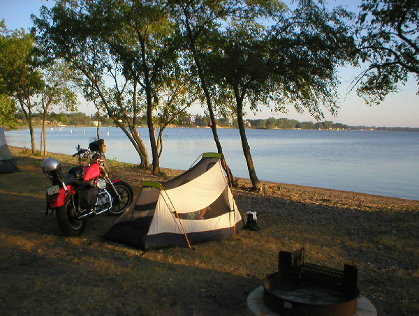 We wake up to a good spot and great weather. Things are looking better today. Heidi gets into using the motorcycle as her vanity. I have the camp broken down and packed up quick. I need to get a motel tonight before we tool into Sturgis. Pierre, SD looked like our only hope.