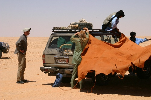 017 - <br /> Day 1 - <br /> Corralling the cars & setting up the camel leather tent for lunch <br /> (Page 2-Image 2)