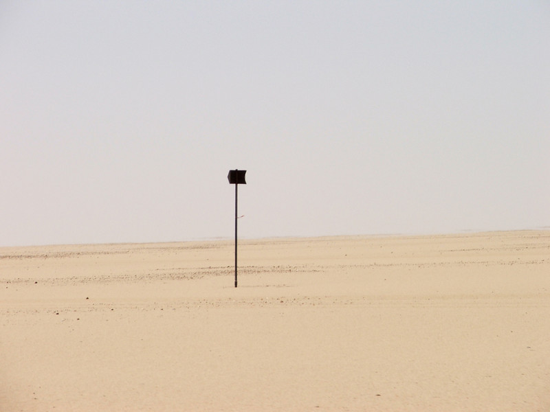031 - <br /> Day 2 - <br /> Sporadic markers march across the desert  <br /> (Page 3-Image 1)