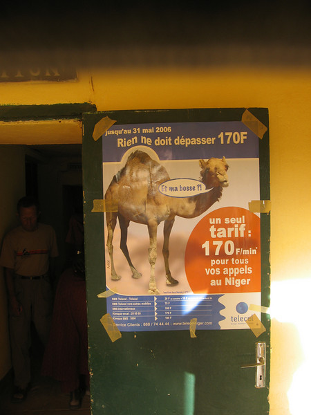 """247 - <br /> Day 7 - <br /> Entrance to Hotel De L'Air in Agadez; """"Who's the Boss?!"""" <br /> (Page 17-Image 7)"""