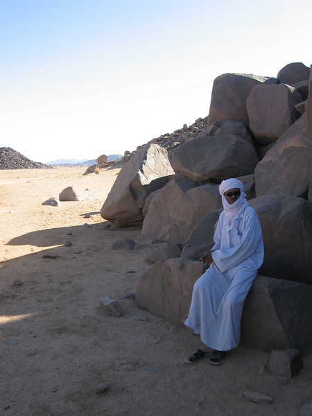 364 - <br /> Day 10 - <br /> Lamin, our driver takes a break in the shade <br /> (Page 25-Image 4)