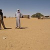421 - <br /> Day 12 - <br /> Lamin & Mohammad, our drivers, check out the town <br /> (Page 29-Image 1)