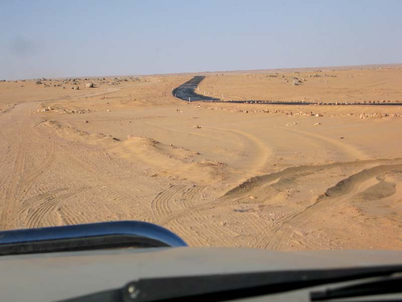 429 - <br /> Day 12 - <br /> The paved roads didn't last!  - A new road is there, but still un-opened, and taunting us all the way to Tamarasset as we make our way through the desert sand . . .  <br /> (Page 29-Image 9)